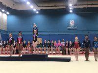 Gymnast holding trophy