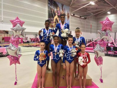gymnasts with prizes and balloons