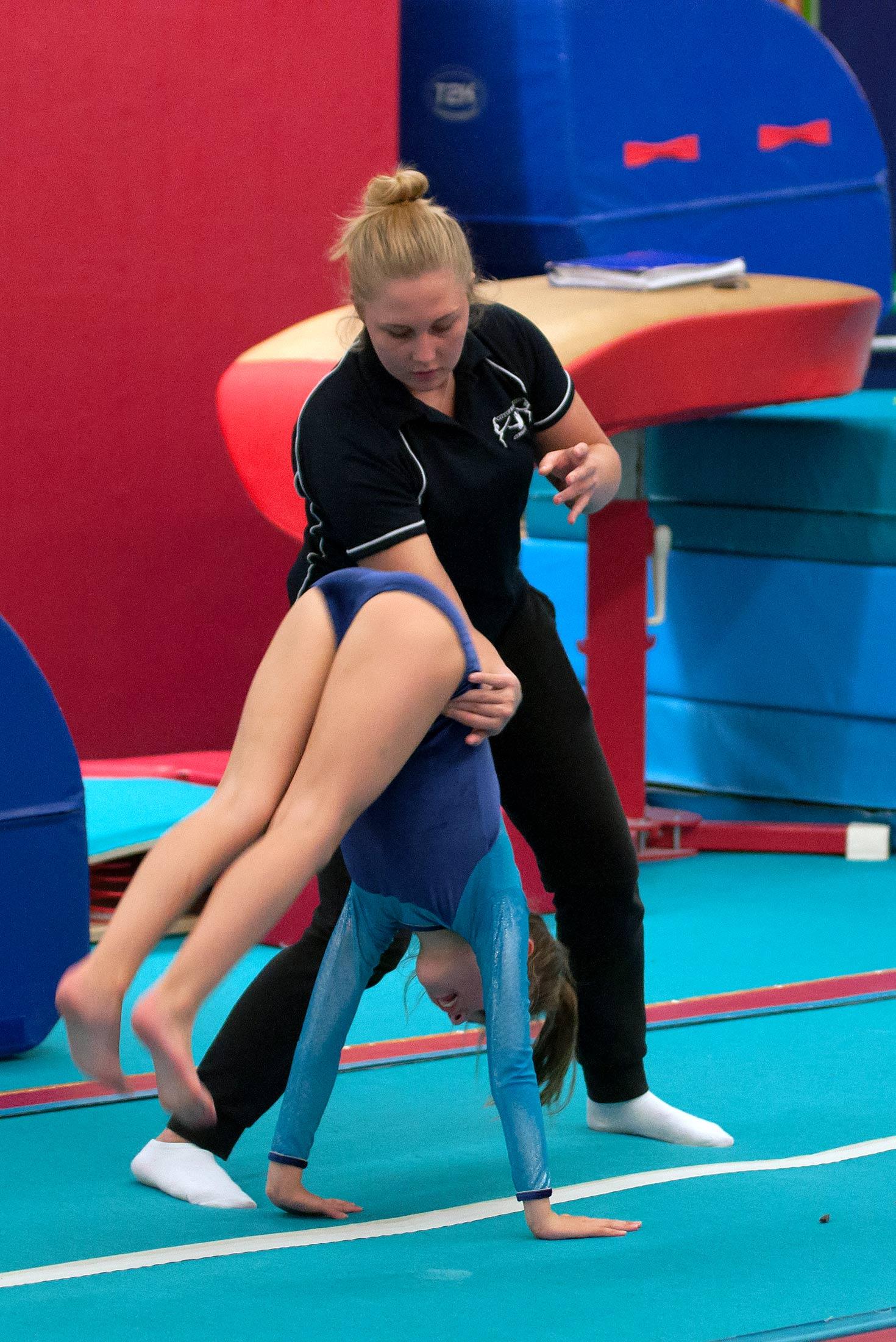 gymnast and coach