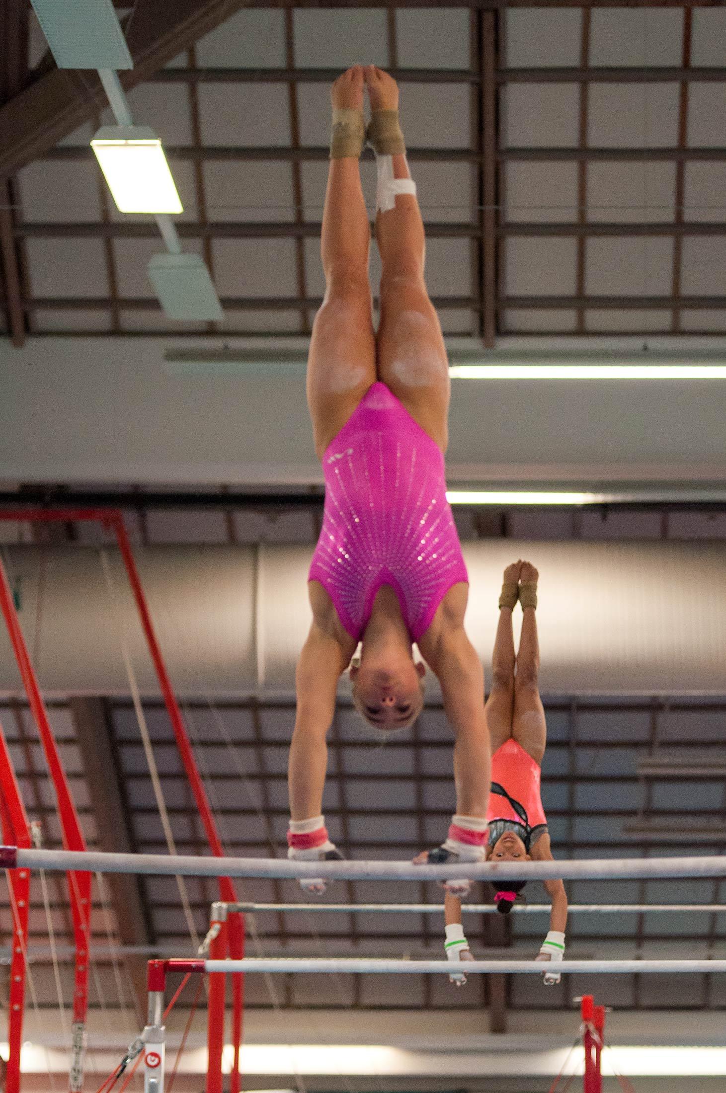 two gymnasts on high bars