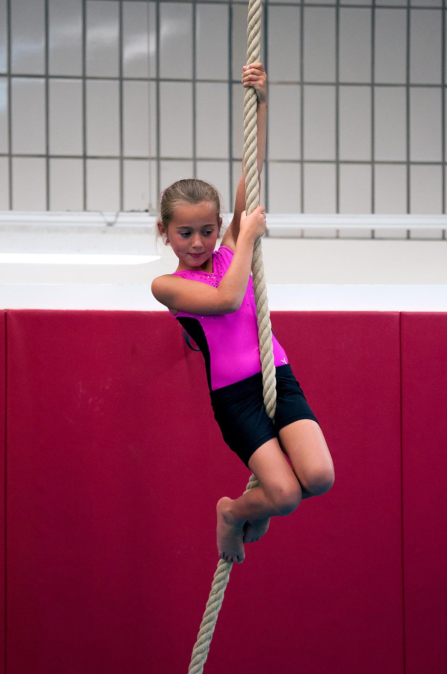 gymnast climbing rope