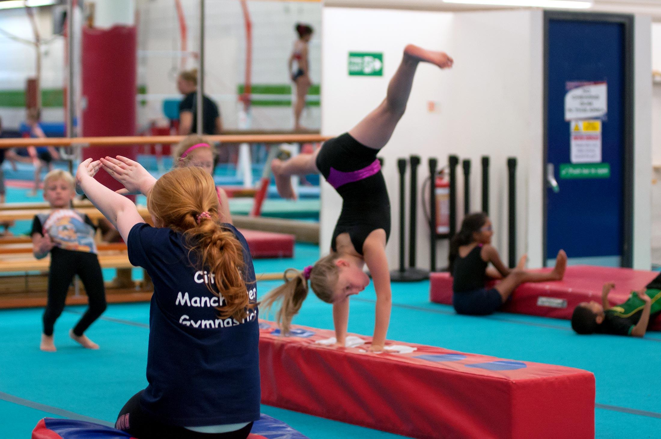 girl performing cartwheels