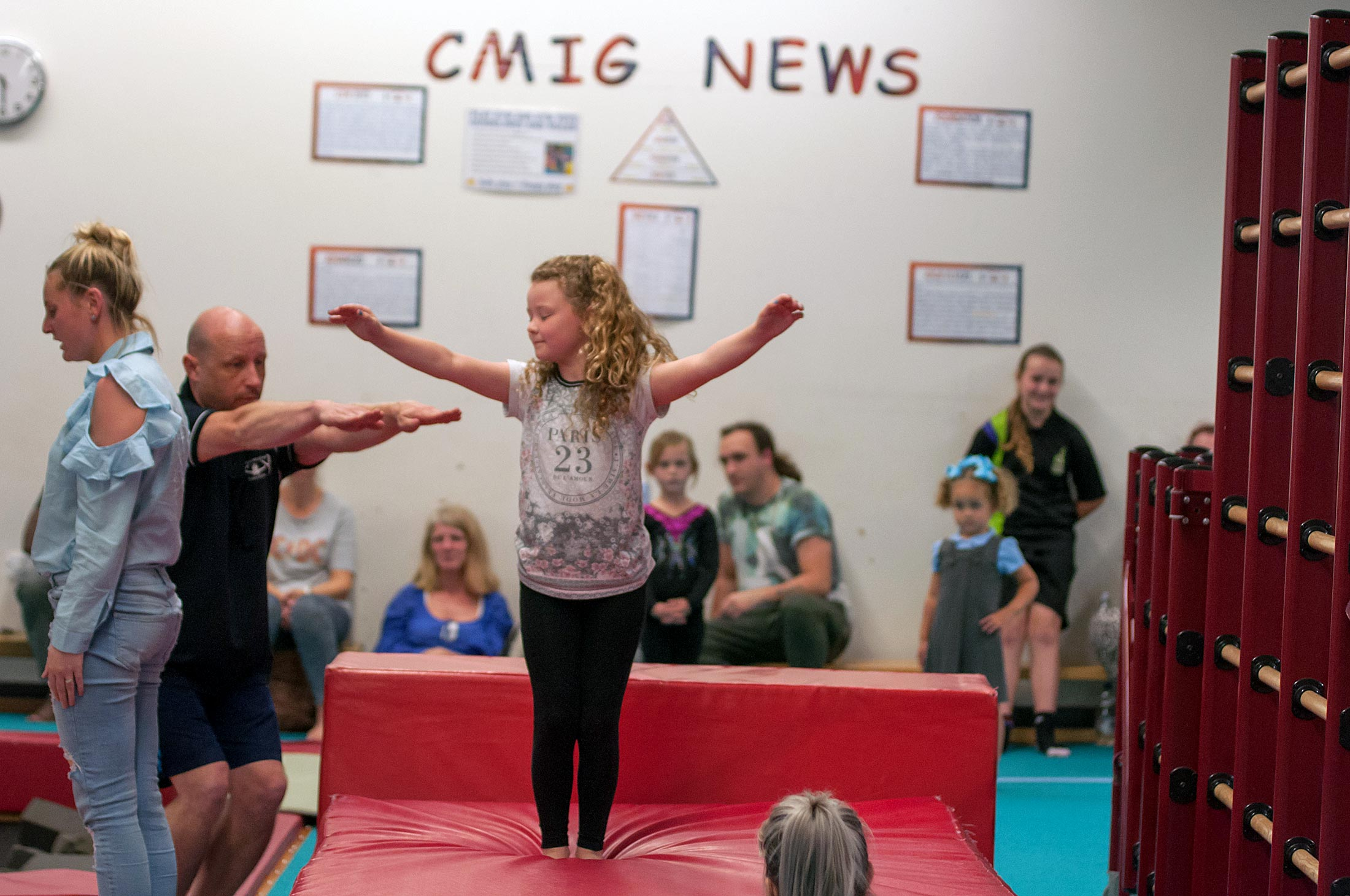 young girl with gymnastics coach