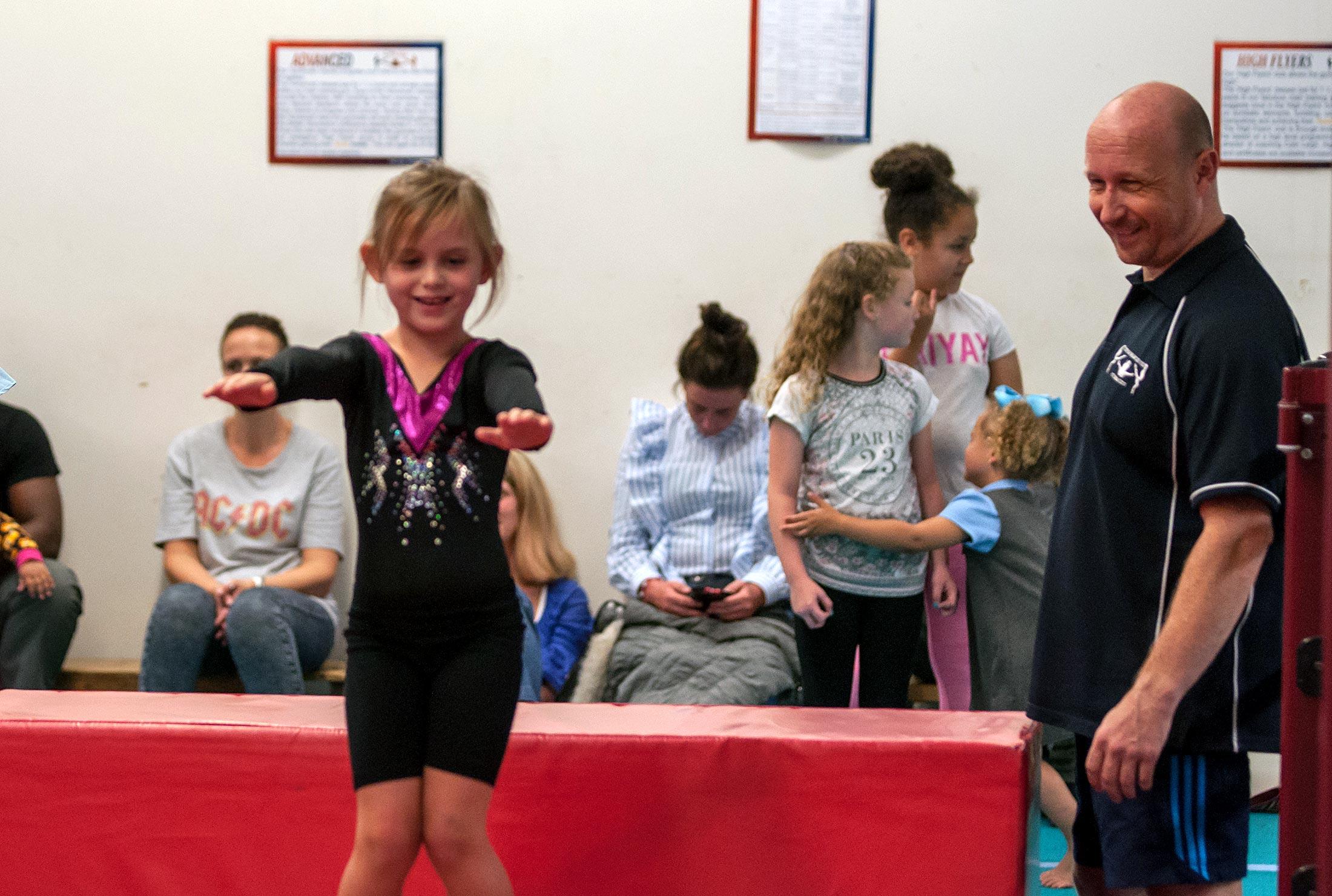 young girl learning gymnastics