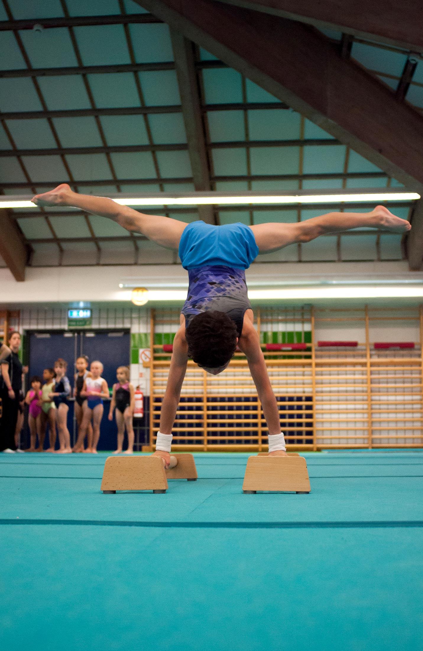 gymnast practicing handstand splits