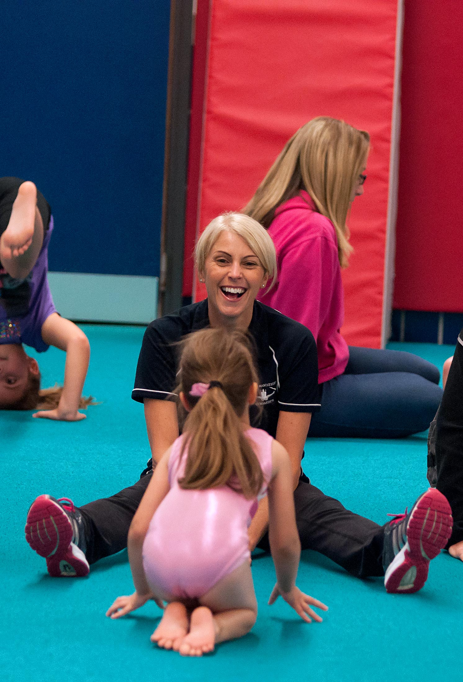 gymnast with coach smiling