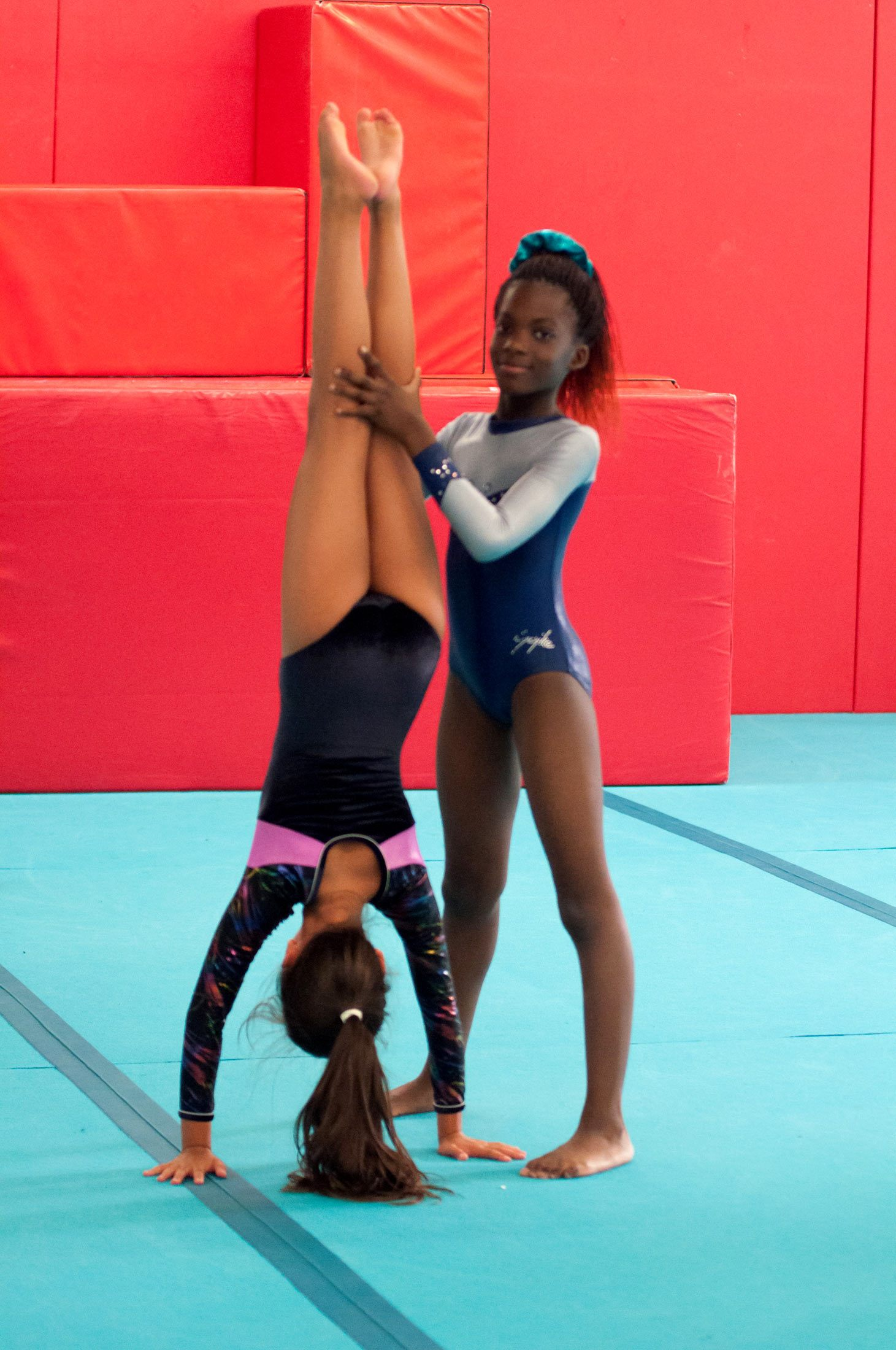 gymnast helping with handstand