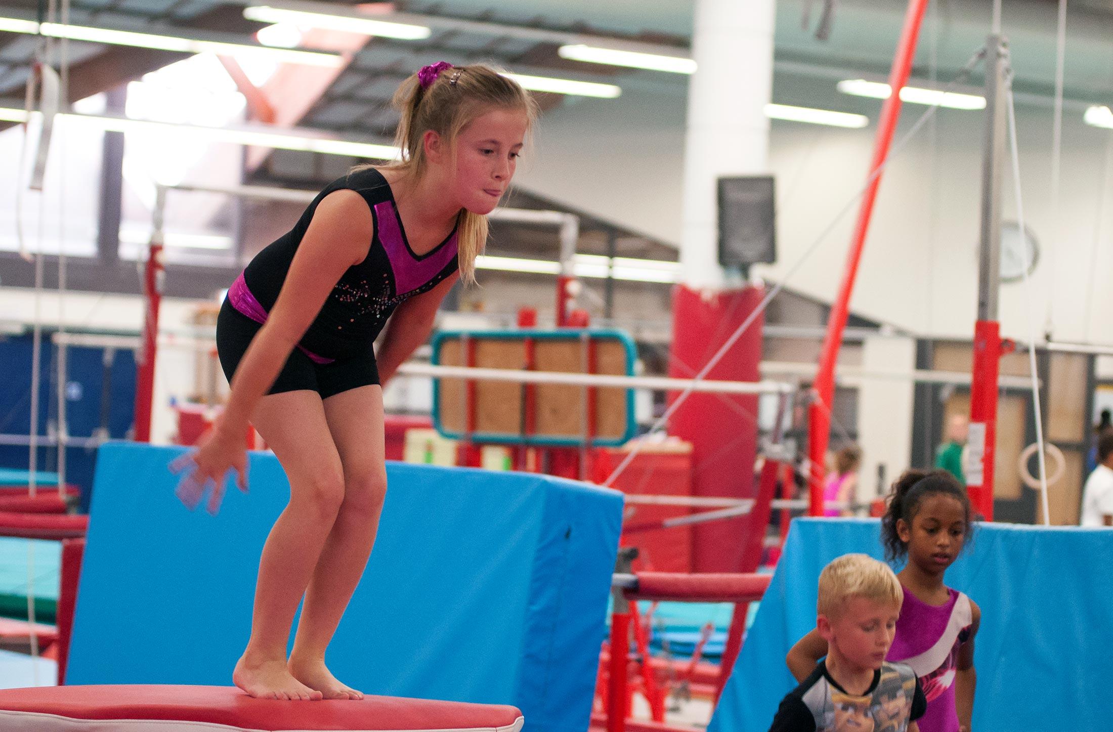 gymnast jumping off vault
