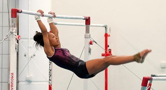 gymnast swinging on bar