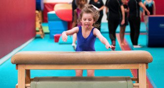 gymnast running at vault horse