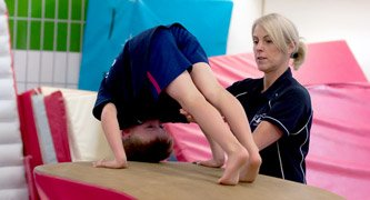 gymnast and coach on vault