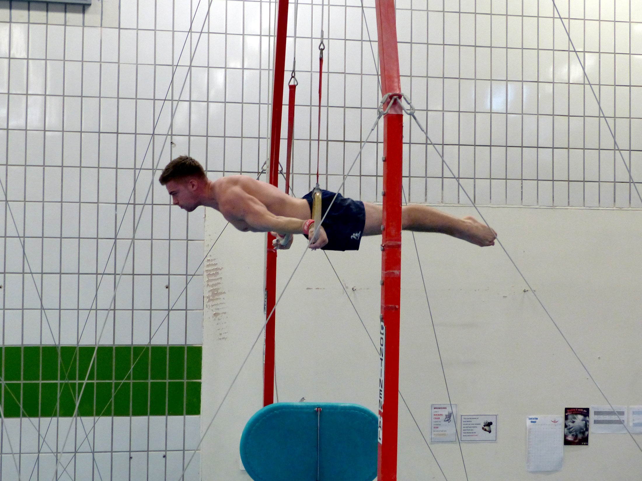 male gymnast strength hold on rings