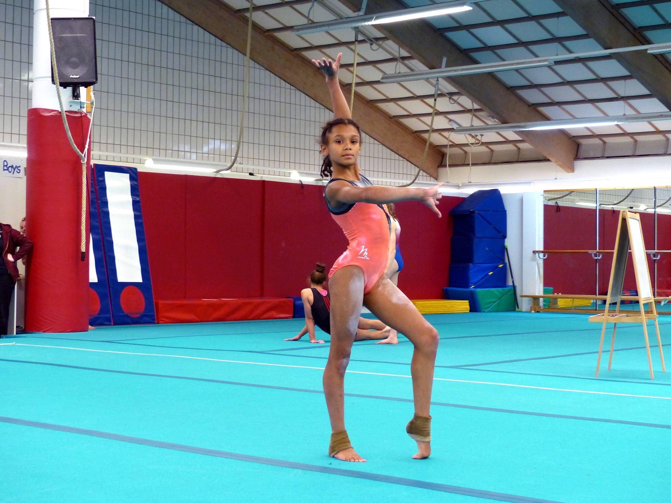 gymnast in pose on floor