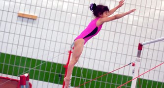 gymnast jumping to catch bar